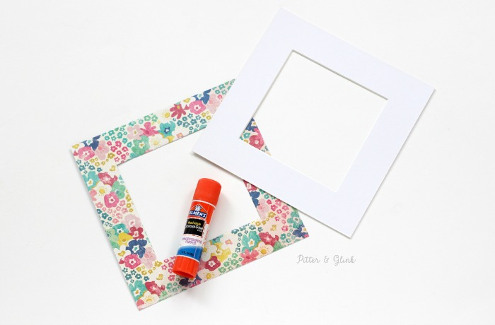 How to Make a Patterned Photo Mat from a Plain Mat--Glue scrapbook paper to the mat.  www.pitterandglink.com