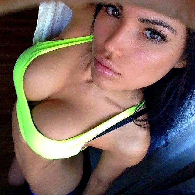 Girl in sports bra cleavage