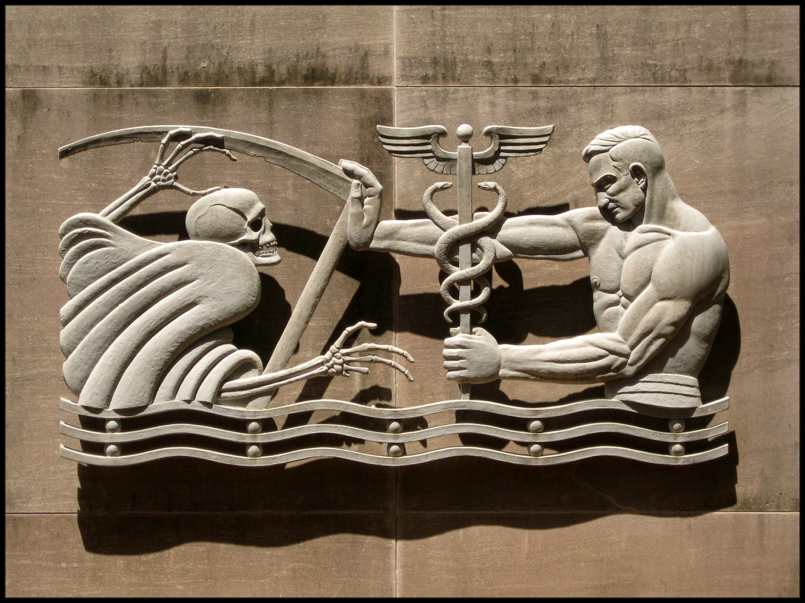 Color shot of a frieze on the exterior of the the Fulton County Dept. of Health and Wellness, a.k.a the county health department, in Downtown Atlanta