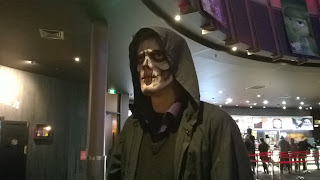 Man facepainted as the Grim Reaper
