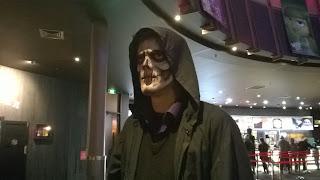 Man facepainted as the Grim Reaper