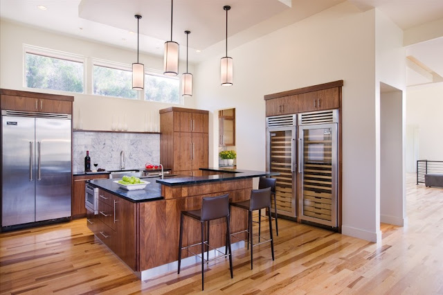 Photo of modern kitchen and kitchen island as seen from another angle