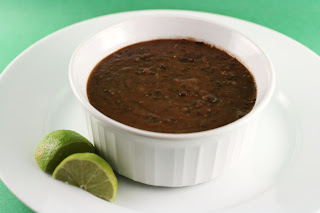 tangy black bean soup in the slow cooker; served with a lemon wedge ...