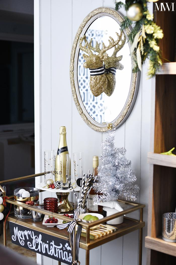 Beautifully styled bar cart that is ready for holiday champagne cocktails!