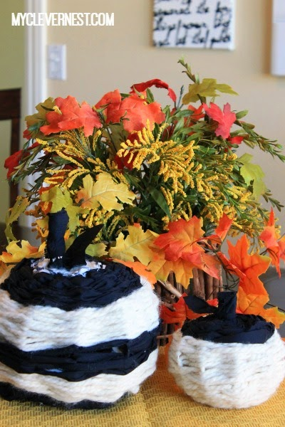 Purdy pumpkins! floral wire woven with yarn and strips of material. Cheap to make, and big impact. They say, bam! I'm a pumpkin. In your face! #DIY4Halloween #JoannFabric #clevernest