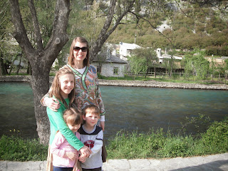 Dr. Muftic with her children along the Buna River.