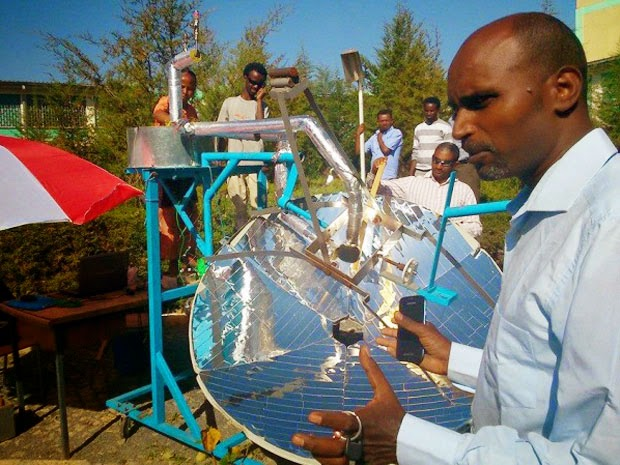 Mechanical engineer Asfafaw Haileselassie Tesfay demonstrated an advanced new solar cooker at Mekelle University in Ethiopia in March, 2014. (Credit: Asfafaw Haileselassie Tesfay) Click to enlarge.