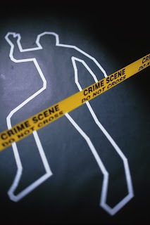 Chalk body outline behind police tape.