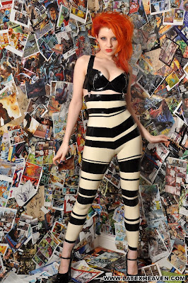 Fetish Redhead Ulorin Vex in Stripey Shiny Latex Catsuit