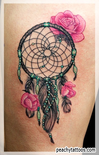 Pink flower and dream catcher tattoo