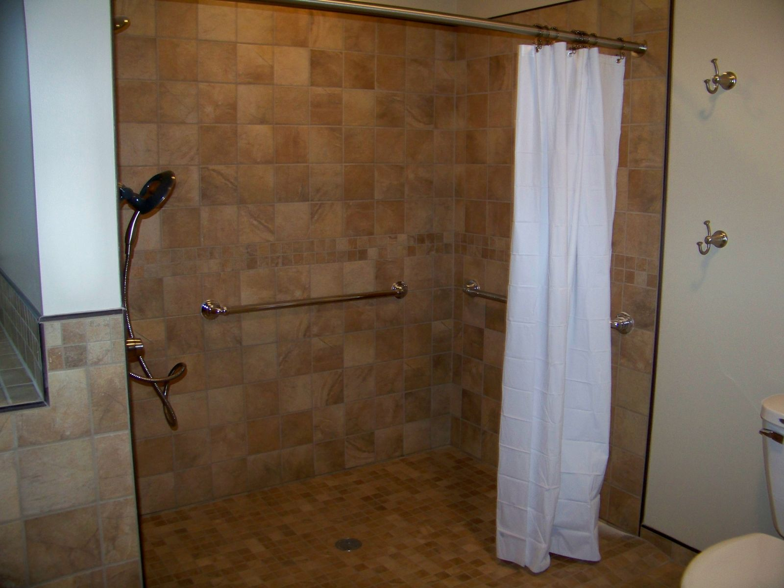 we install quite a few curbless showers most of the showers we install are tile but we do install prefab showers as well i like the prefab showers when