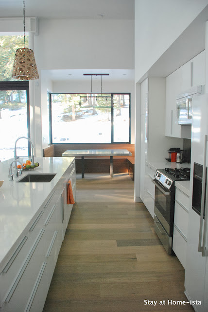 View through Ikea kitchen to built in dining nook
