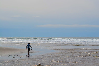 photo of boy playing on Rockaway Beach by Nancy Zavada