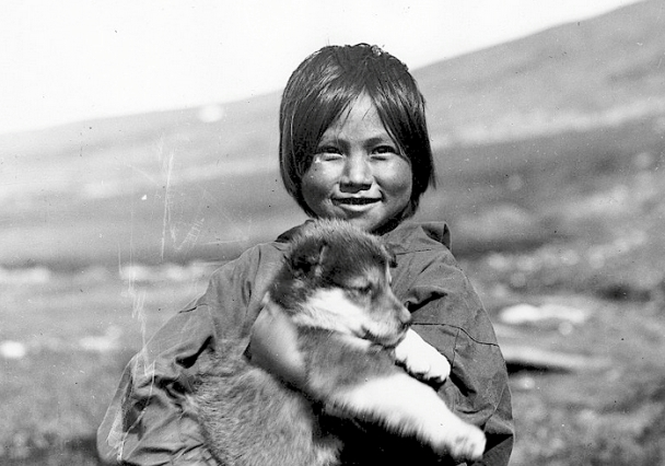 Inuit girl with puppy. 1922. Alaska. Photo by Alfred M. Bailey. Source - University of Wyoming, American Heritage Center