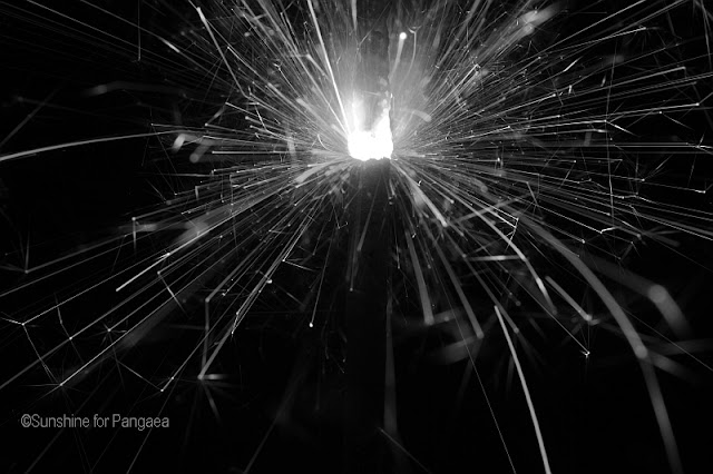 Black and white macro photo of a sparkler