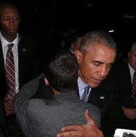 Obama hugs Ahmed the bomb clock maker