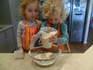 Sifting flour into a bowl for rainbow cake.