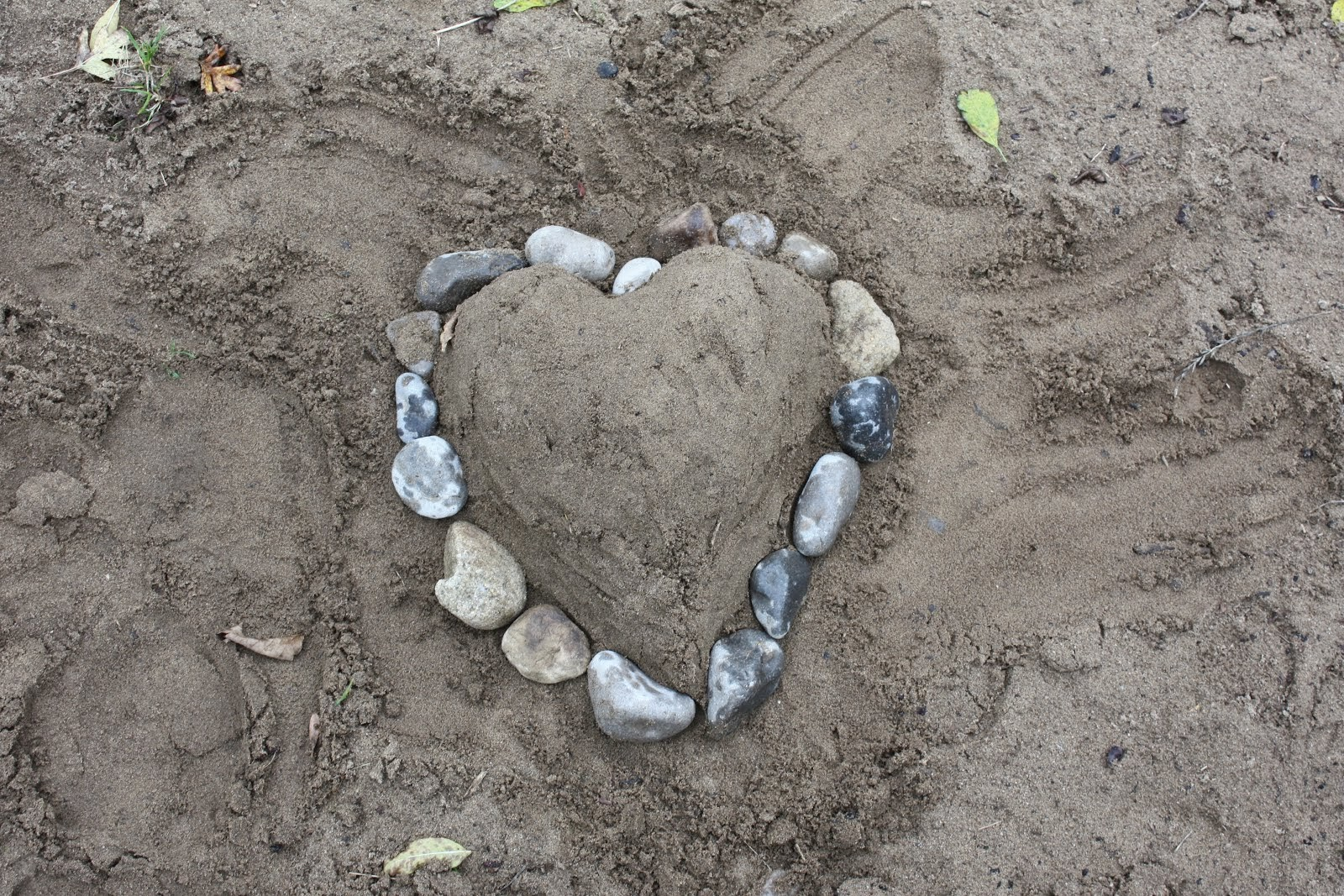 Making hearts in the sand...