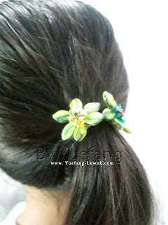Wearing_beaded_flower_attach_to_hair_band