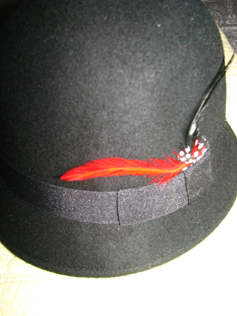 cloche hat with feather detail