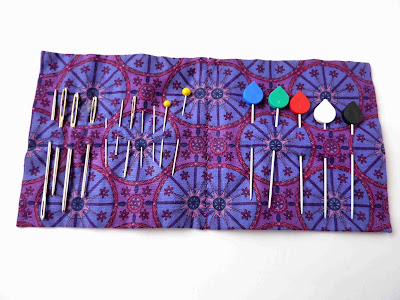 Needle case with pins and needles