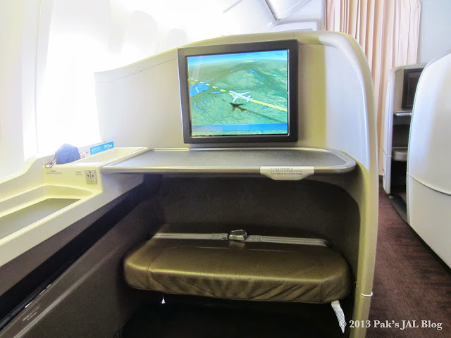 JAL Suite's comes with an ottoman and an adjustable table