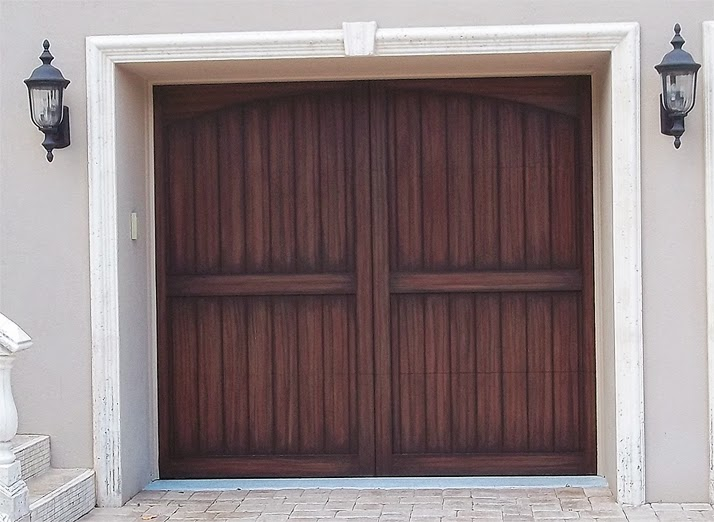 Painting carriage style garage doors to look like wood for Wood garage doors michigan