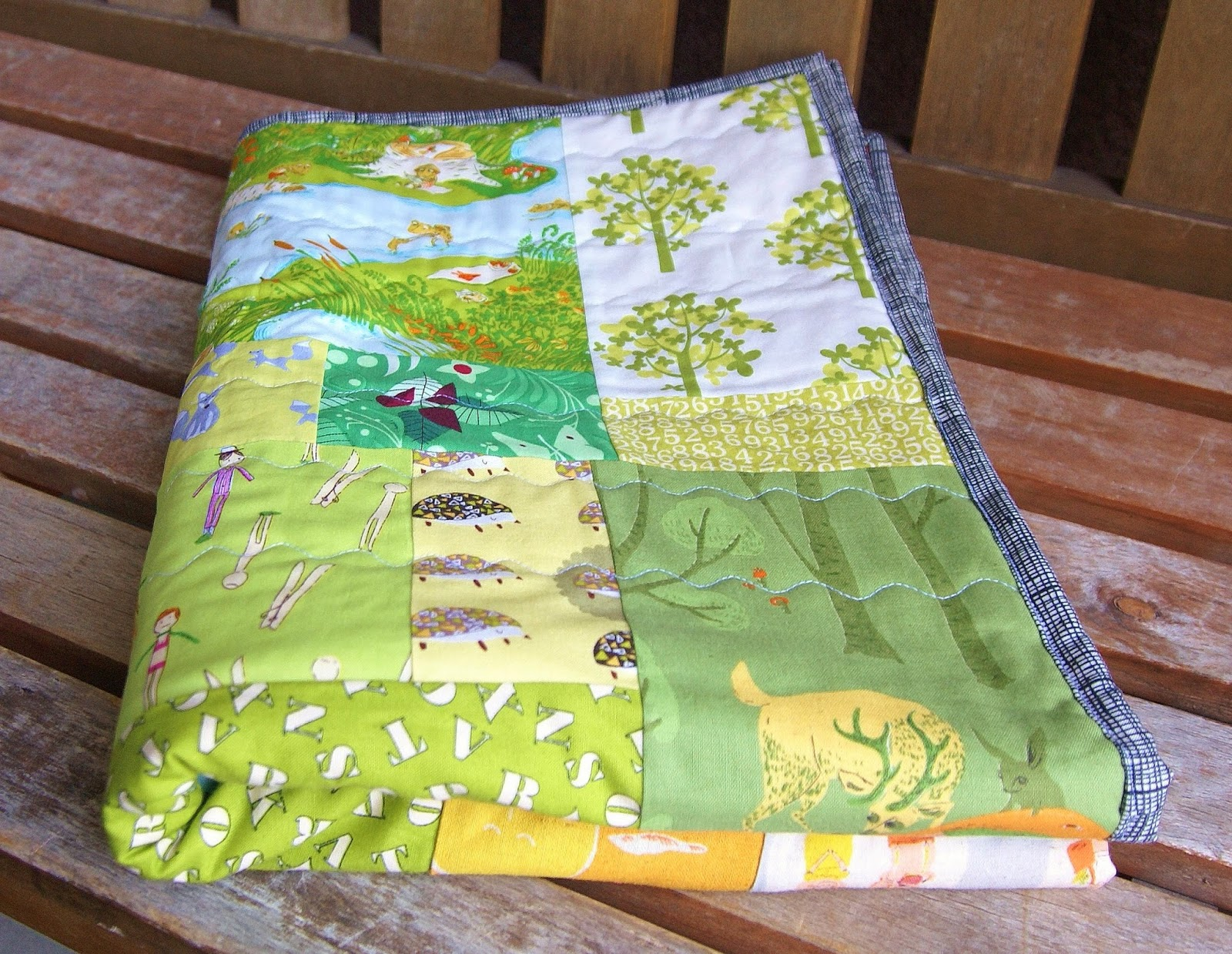 Rainbow Patch Scrappy Baby Quilt by Heidi Staples of Fabric Mutt