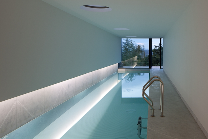 Swimming pool in Black Concrete House by Pitagoras Arquitectos