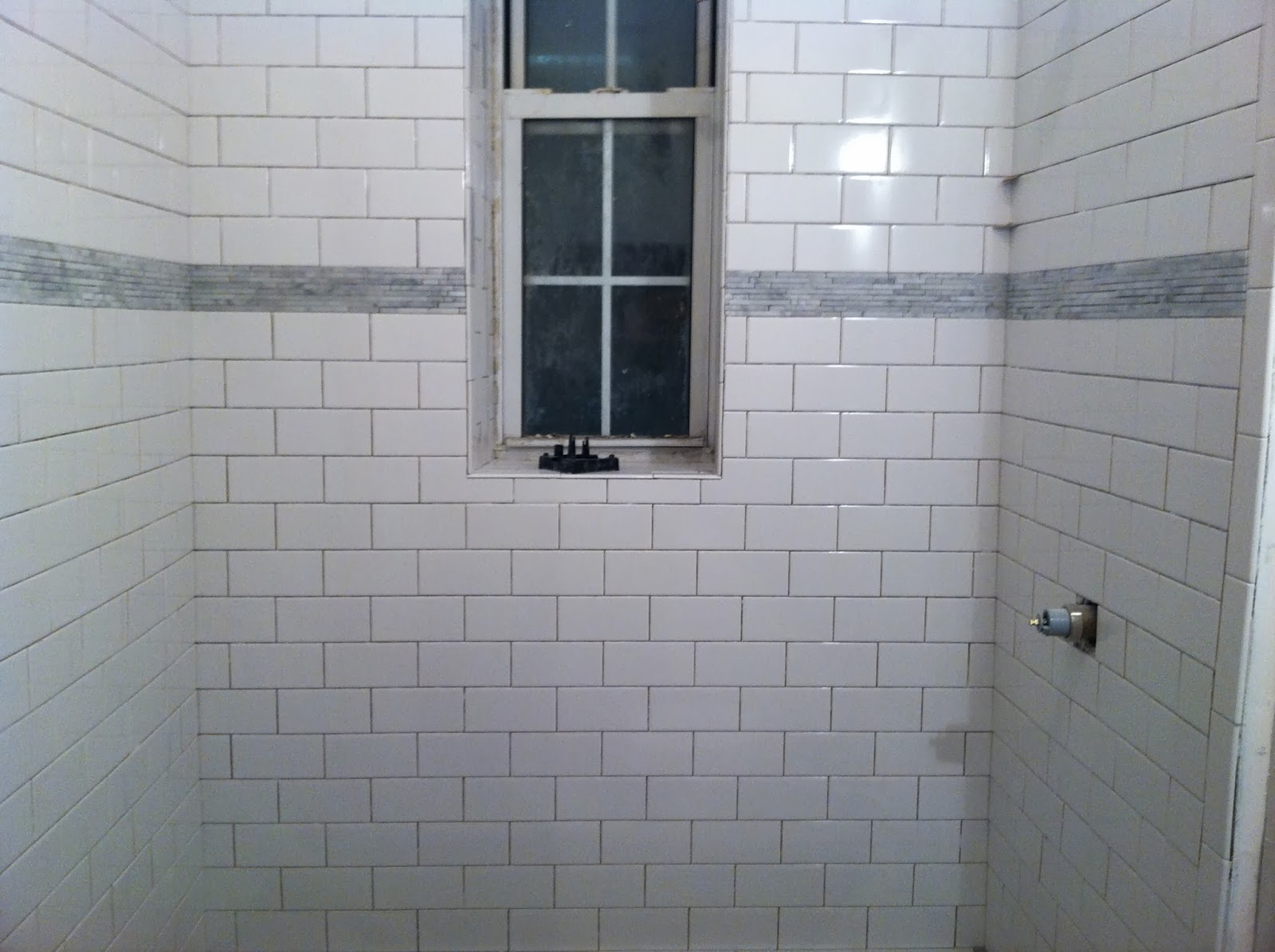 Popular Bathrooms Shower And Sink Area Fitted With White Brick Tiles