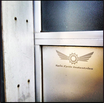spin cycle industries logo on door