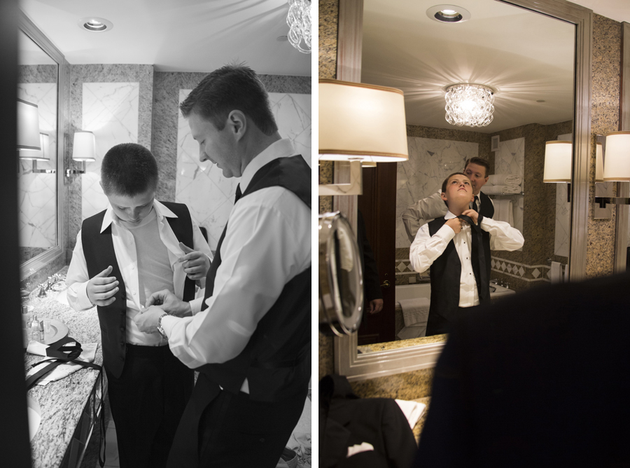 candid groomsmen getting ready in New York Palace hotel bathroom before wedding ceremony