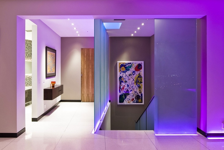 Hallway with purple light in Hollywood Mansion by Whipple Russell Architects