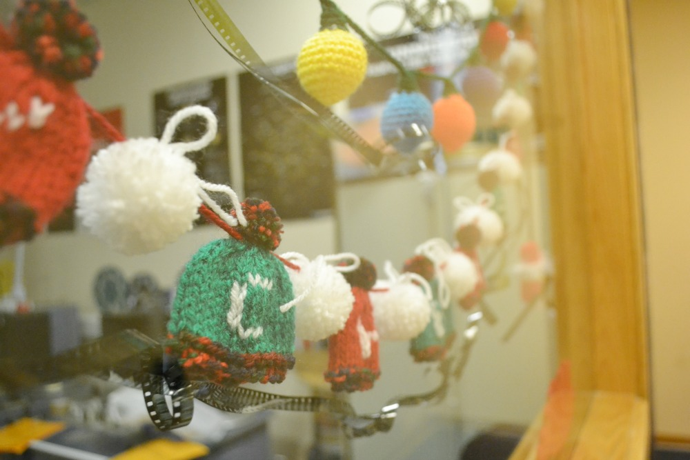 bobble hat bunting christmas window knitted pompoms crochet lights