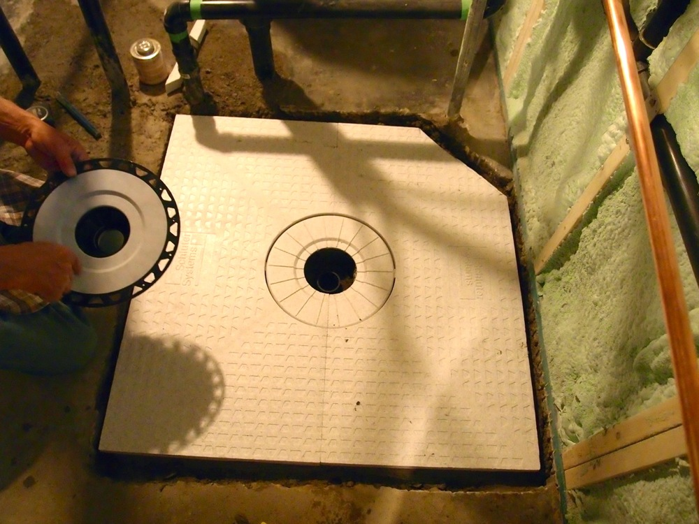 the schluter kerdi shower tray being set into place this foam tray is presloped so we can set our tiles right on and not have to worry about building a