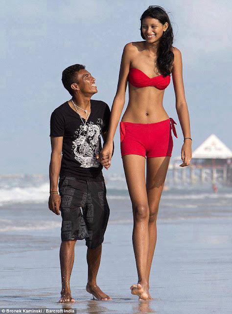World's tallest teen. girl 6-9 and boy 5-4 feet