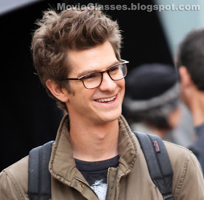 Andrew Garfield smiling and wearing Oliver Peoples eyewear on the set of The Amazing Spider-Man