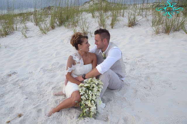 Sharing another romantic moment on their beach wedding day