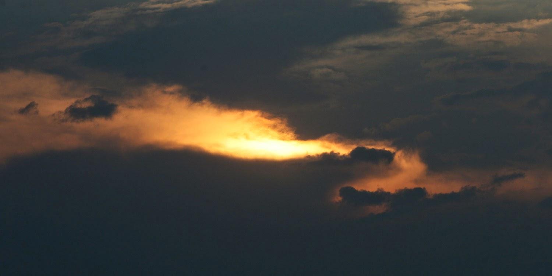 Sun descending through the clouds