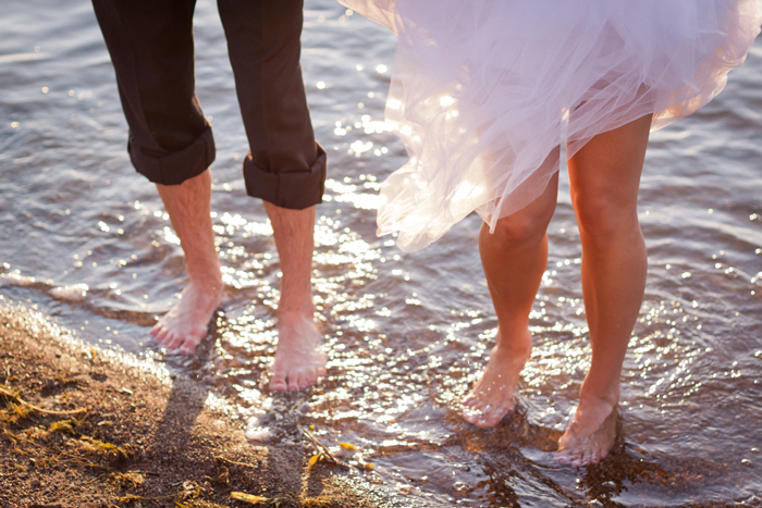 Bride & groom wading photo, getting wet for wedding photos, wedding photos wading in the lake, barefoot wedding photo