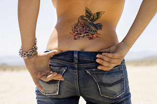 Humming bird Tattoo design on girls lower back