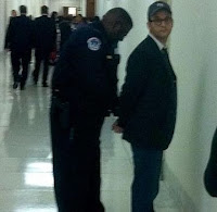 Photo of Josh Fox being handcuffed by a Capitol police officer
