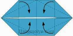Bước 4: Gấp chéo bốn cạnh tờ giấy vào trong.