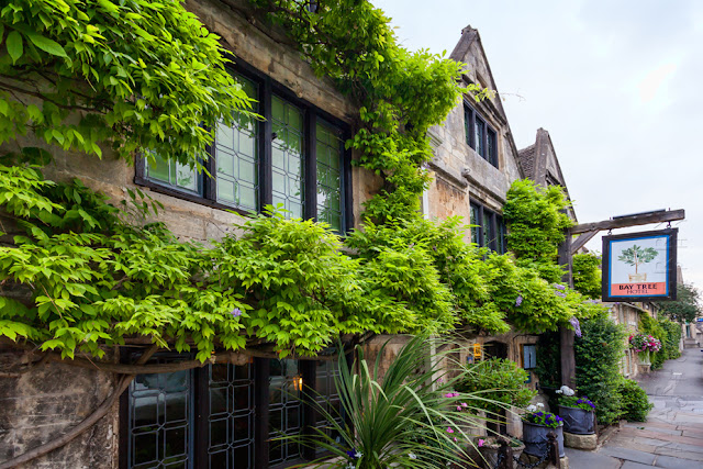 This beautiful Cotswold building houses The Bay Tree Hotel by Martyn Ferry Photography