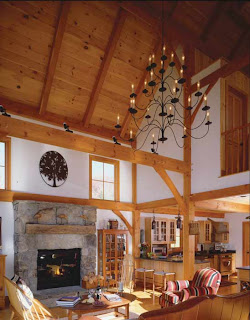 this timber frame great room features a cathedral ceiling