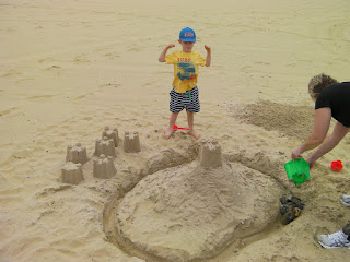sandcastle with moat, motte and bailey