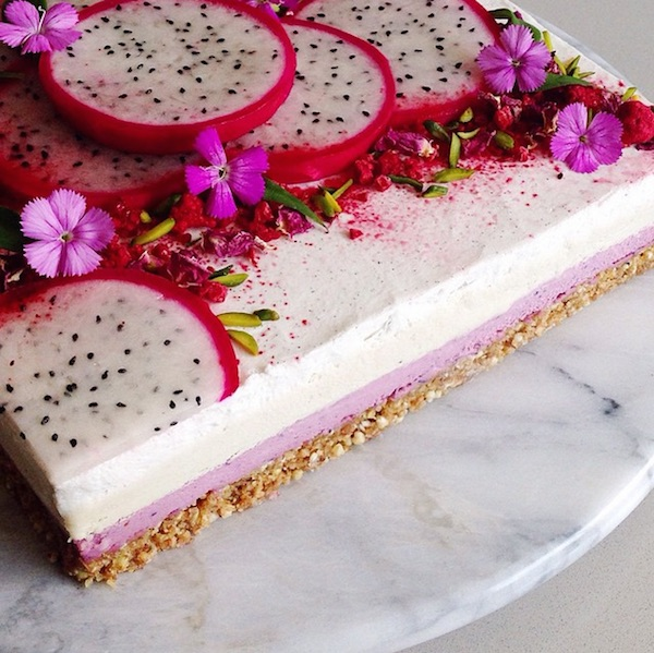 raw vegan cheesecake layer of mixed berry cream with flower