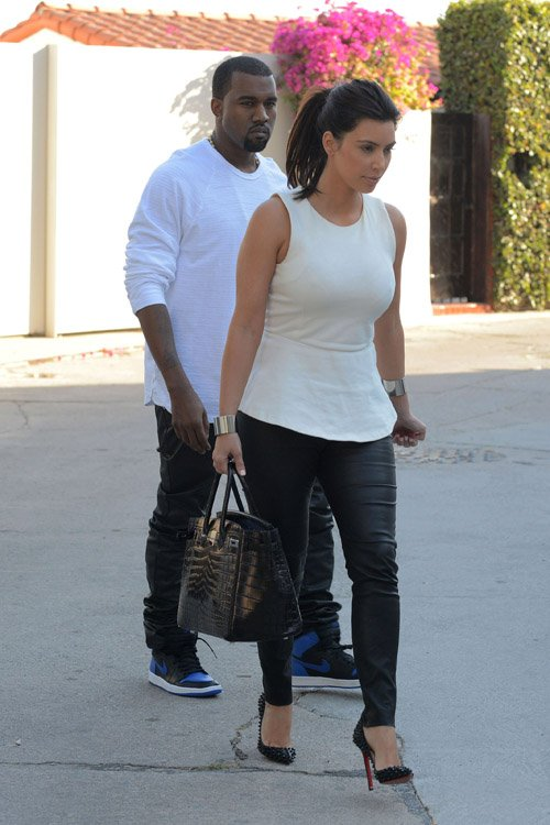 Kanye West wearing the Air Jordan 1 Hi black varsity royalJordan 1 Royal Blue Kanye