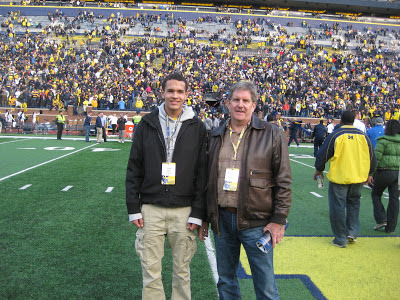 Derek Kief with grandfather Pat Kief on unofficial visit to UM game