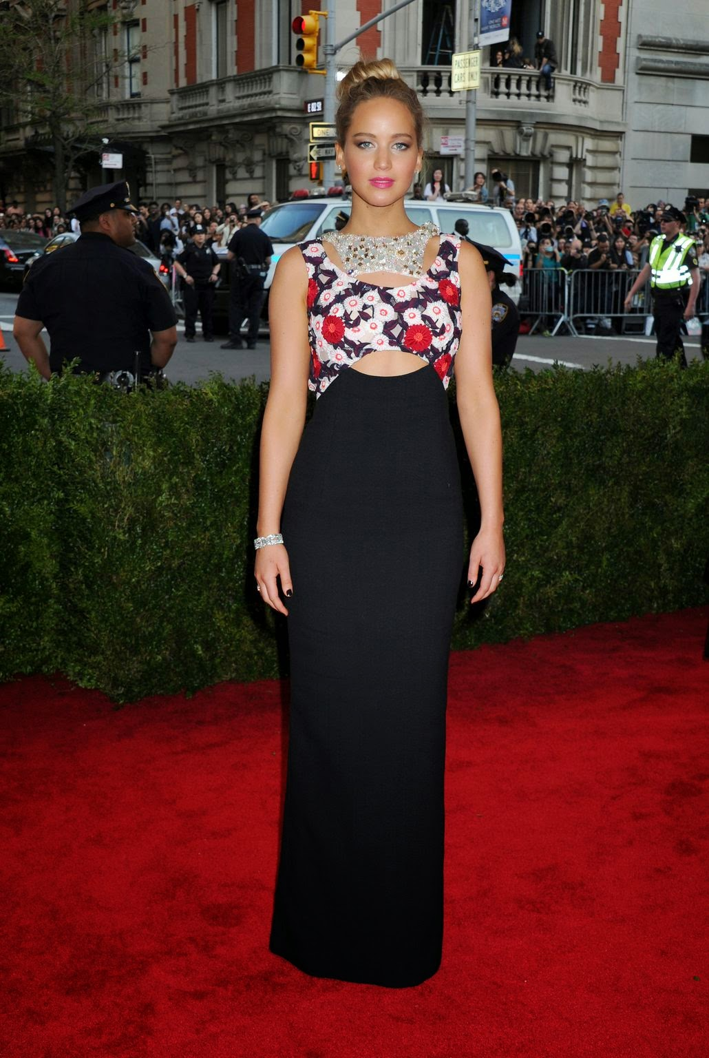 Jennifer Lawrence wears figure hugging Dior Couture to the 2015 Met Gala in NYC